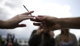 People smoke a joint during a demonstrat