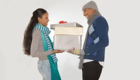 Couple holding christmas gifts