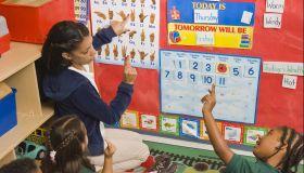 Teacher showing pre-school children sign language