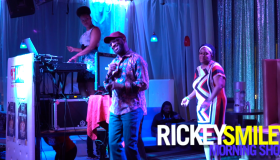 Rickey Smiley & a fan at karaoke