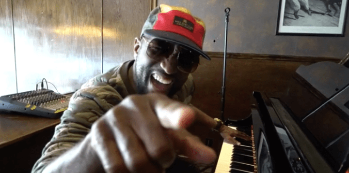 Rickey Smiley playing the piano.