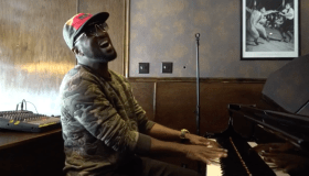 Rickey Smiley playing piano