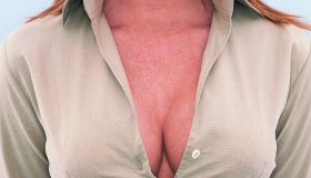 Mid Section View of a Young Businesswoman's Cleavage