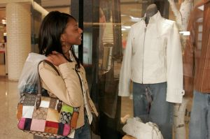 A woman looking a clothes in a store window at Westfield Shoppingtown Southlake.