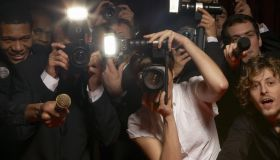 Paparazzi photographers and television reporters at celebrity event