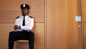 Security guard sitting by office door