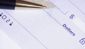 Pen over a blank check