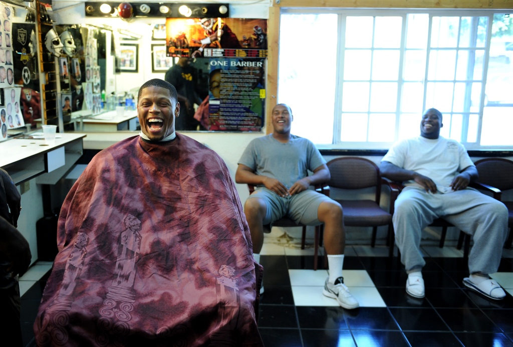 USC defensive end Nick Perry, left, shares a laugh with fellow linemen Armond Armstead and DaJohn H