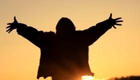 A Silhouette of a Joyful Person