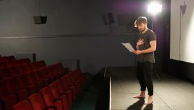 Actor rehearsing his lines on stage.