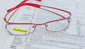 Tax form and eyeglasses