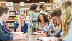 Teens Hanging Out In Library