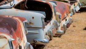 Tail ends of Holden FBs, FCs and FEs in wrecking yard.
