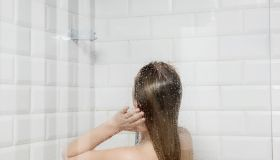 Close-Up Of Young Woman In Bathroom