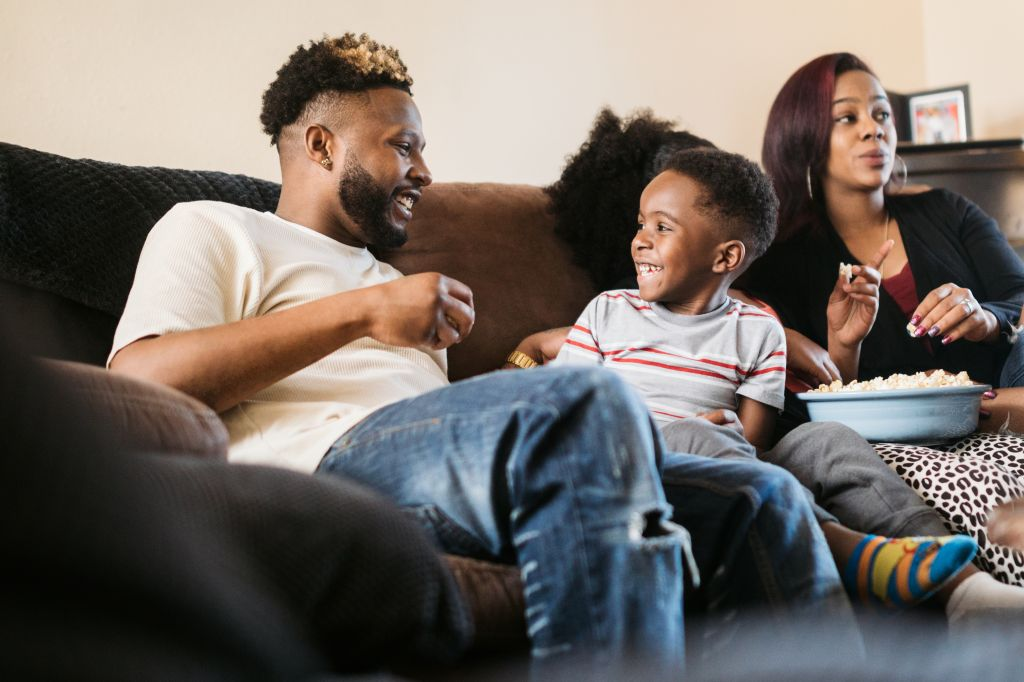 A Family Watches a Movie Together at Home