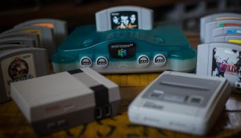 A Japanese edition of the Nintendo 64 clear blue version (M...