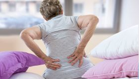 Senior woman suffering from lumbar pain.
