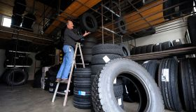 An employee stores new winter tyres in a