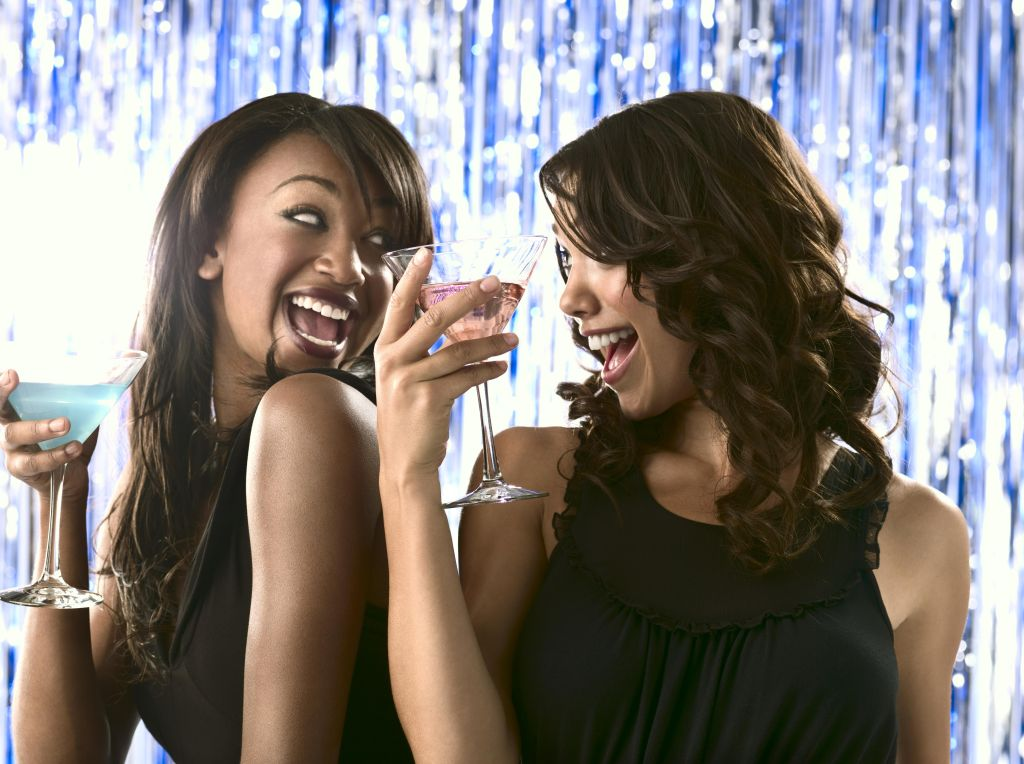 Two females drinking martinis
