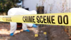 Close-Up Of Cordon Tape On Crime Scene