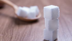Close-Up Of Sugar Cubes On Table