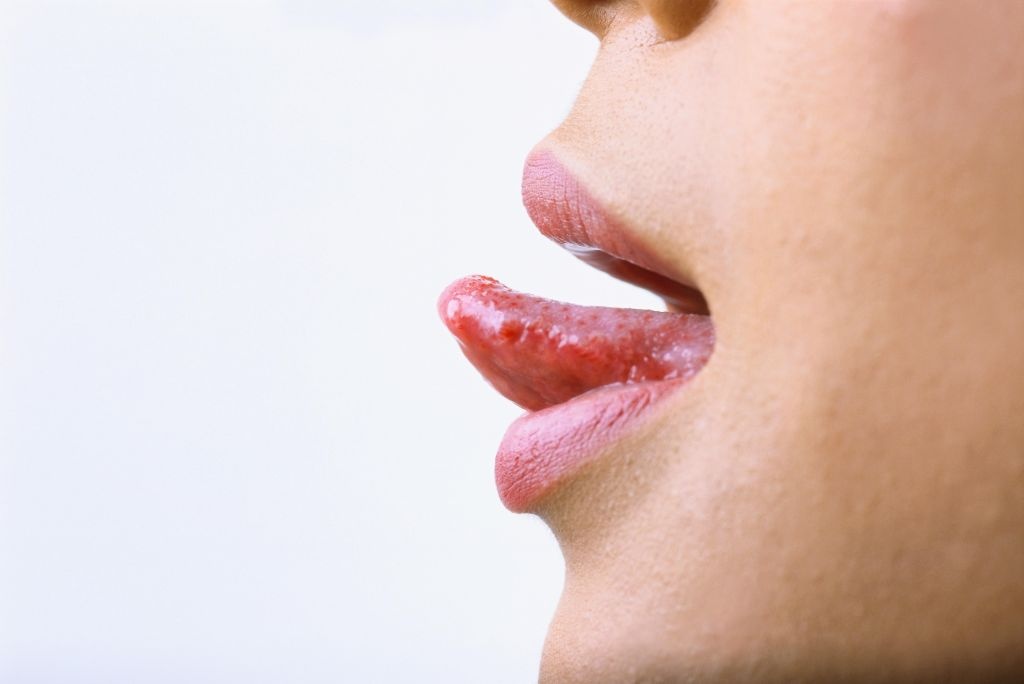 close-up of a woman sticking her tongue out