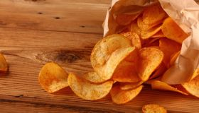 High Angle View Of Potato Chips On Table
