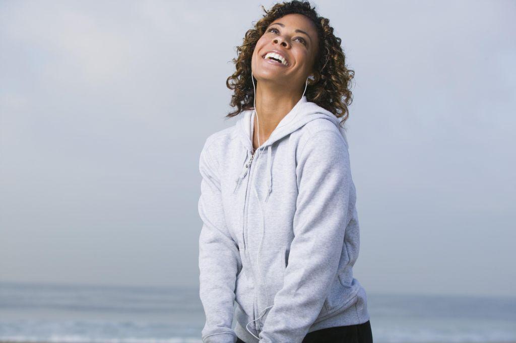 Happy woman listening to headphones