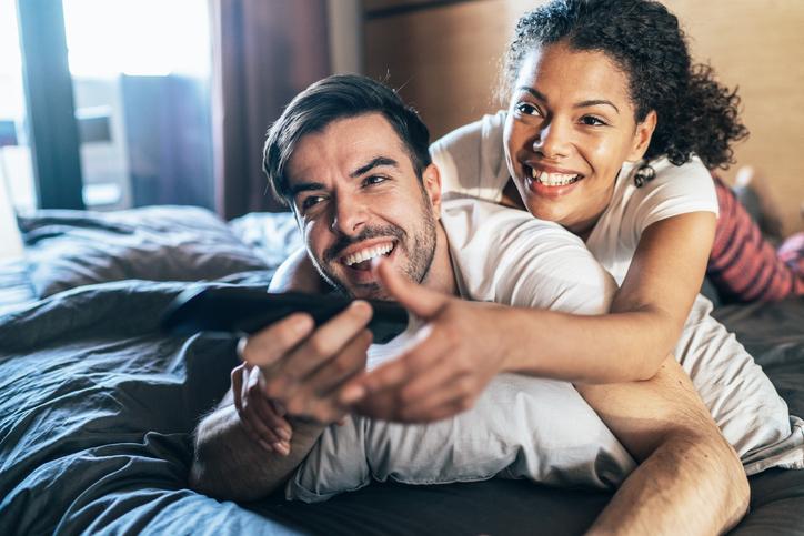 Happy couple watching tv