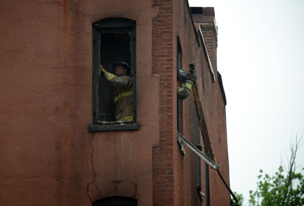 WASHINGTON, DC - JUNE 3: DC fire fighters clean out debris whil