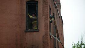 WASHINGTON, DC - JUNE 3: DC fire fighters clean out debris whil