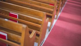 High Angle View Of Pews By Aisle At Church