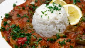 Shrimp dish with white rice on a white plate