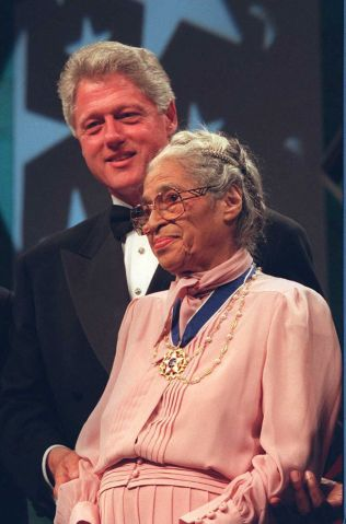 US President Bill Clinton stands with civil rights