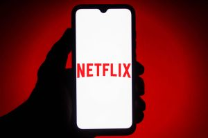 In this photo illustration the Netflix logo seen displayed...